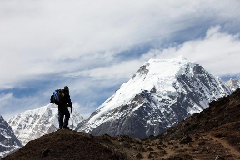 Nepal Trekker below high Himalayan Peak near Makalu Base Camp