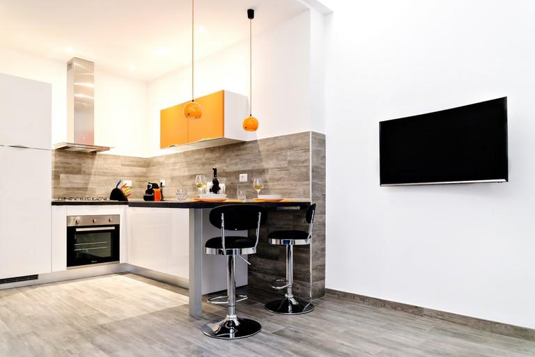 The kitchen of the Domus Stellarum Polaris apartment in Ostiense, Rome
