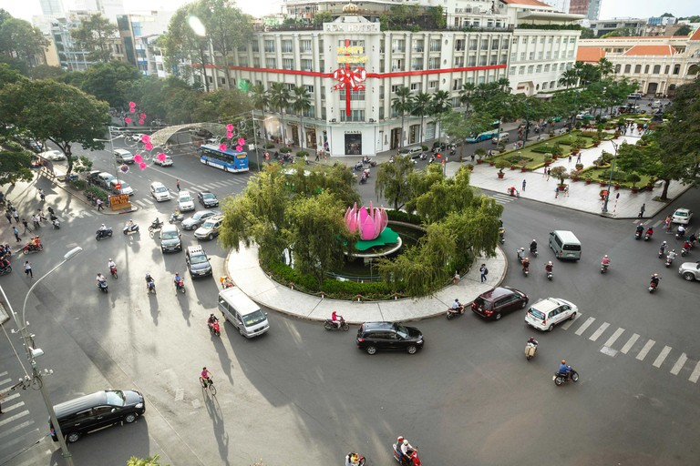 Traffic intersection Nguyen Hue boulevard and Le Loi boulevard, Ho Chi Minh City (Saigon), Vietnam, Indochina, Asia