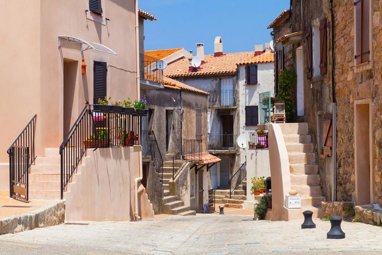 Narrow street of Piana town, Corsica island