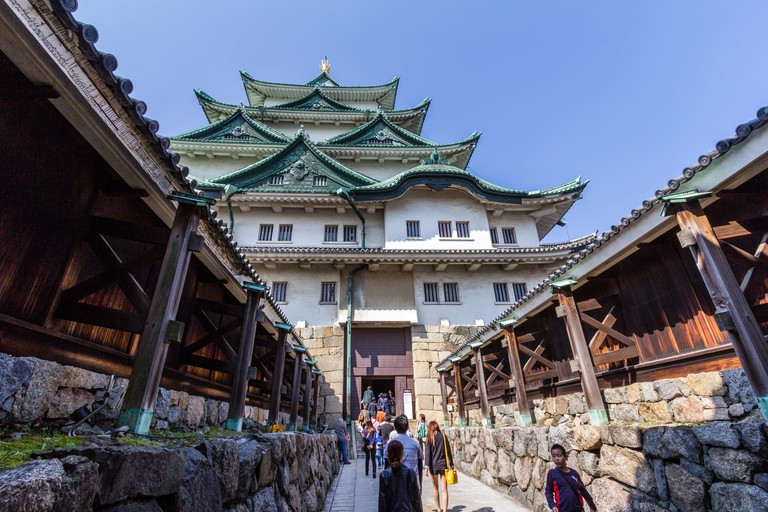 Nagoya castle in Japan. Renketsushiki style keep. Keep and watariyagura, the connecting corridor from keep to smaller connected yagura, turret. People.