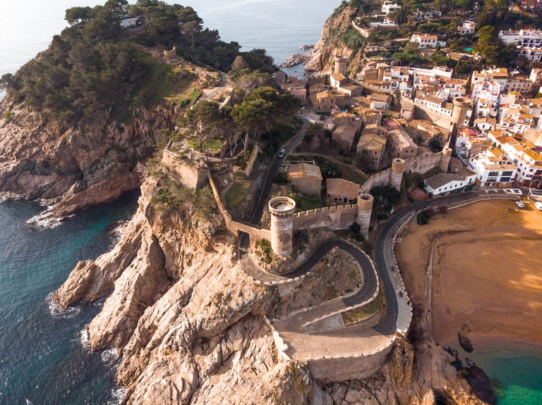 Beautiful fortification town in the Costa Brava coast of Spain with the colors of the sea