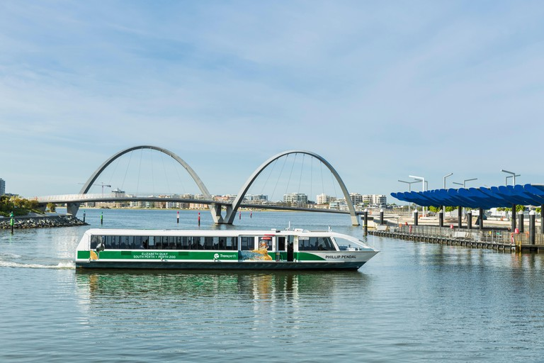A Swan River ferry arriving at Elizabeth Quay ferry terminal with Elizabeth Quay pedestrian bridge beyond.  Perth, Western Australia, Australia. Image shot 11/2016. Exact date unknown.