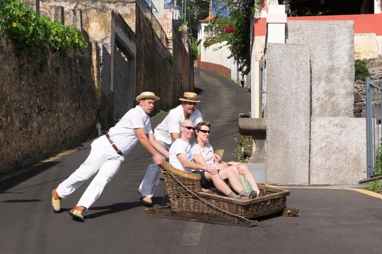Tourists enjoying the Monte toboggan run, Madeira