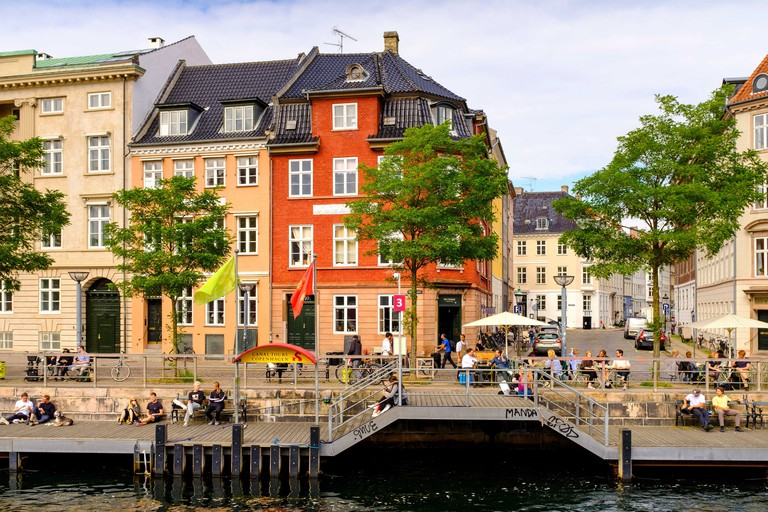 Copenhagen, Zealand region / Denmark - 2017/07/26: panoramic view of the city center and tenement homes at Ved Stranden street