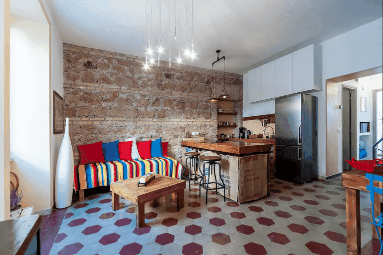 The eclectic living space of Open Upon a Time Airbnb
