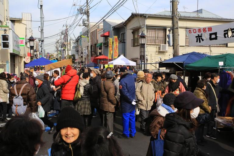 People walk in Setagaya Boro-ichi Market Tokyo/Japan - January 15 2018: people walk in Setagaya Boro-ichi Market in tokyo. Setagaya Boro-ichi is a Tokyo-designated intangible folk cultural as