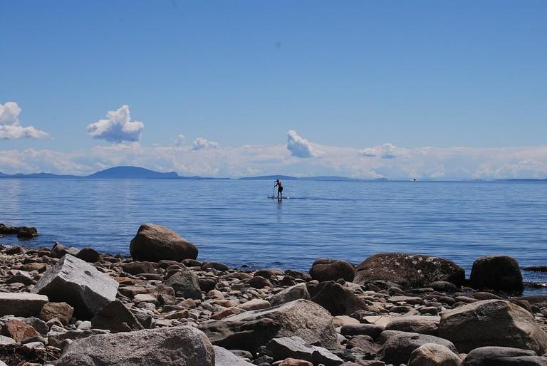 water-rocks-paddleboard-beach