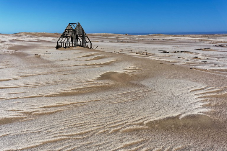 Abandoned wooden building in the desert on the Skeleton Coast, Namibia, Africa.
