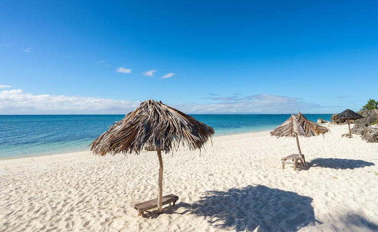 Umbrellas on the beach. Philippines. Bantayan Island   © upslim/Shutterstock