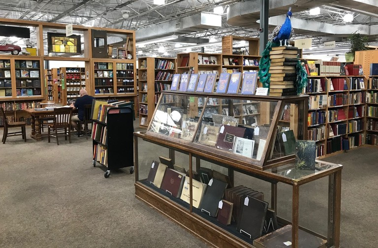 Half Price Books Flagship has plenty of wooden tables and chairs to sit and read