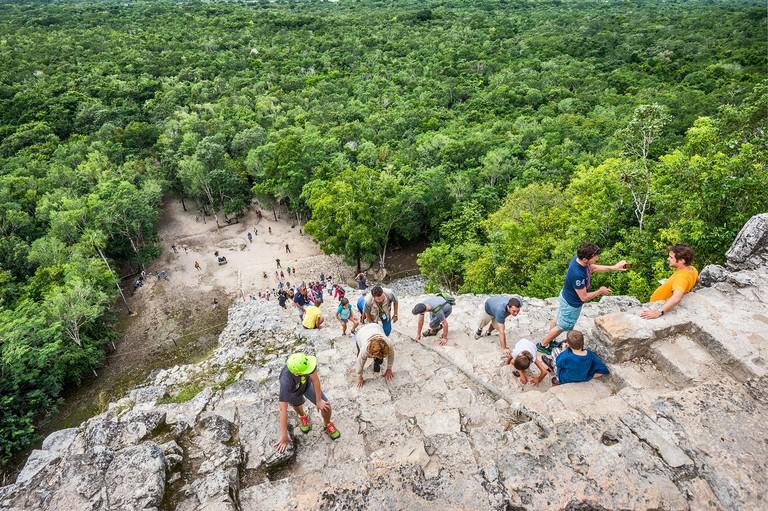 Tourists climbing Nohoch Mul pyramid, Coba Archeological Area, Yucatan Peninsula, Quintana Roo state, Mexico
