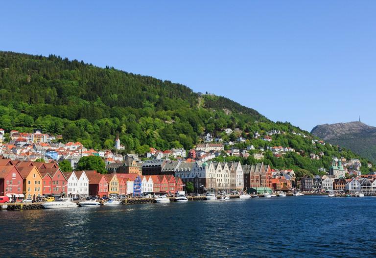 Medieval Hanseatic buildings on Bryggen wharf from Vagen harbour, Bergen, Hordaland, Norway.