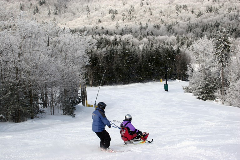 Woman with a disability learning to sit ski at Snowshoe Resort, West Virginia. Image shot 2014. Exact date unknown.