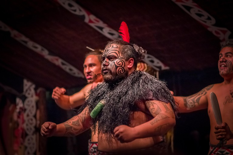 Tamaki Maori leader dancing with traditionally tattooed face