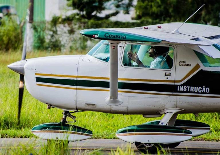 Pilots in plane on runway
