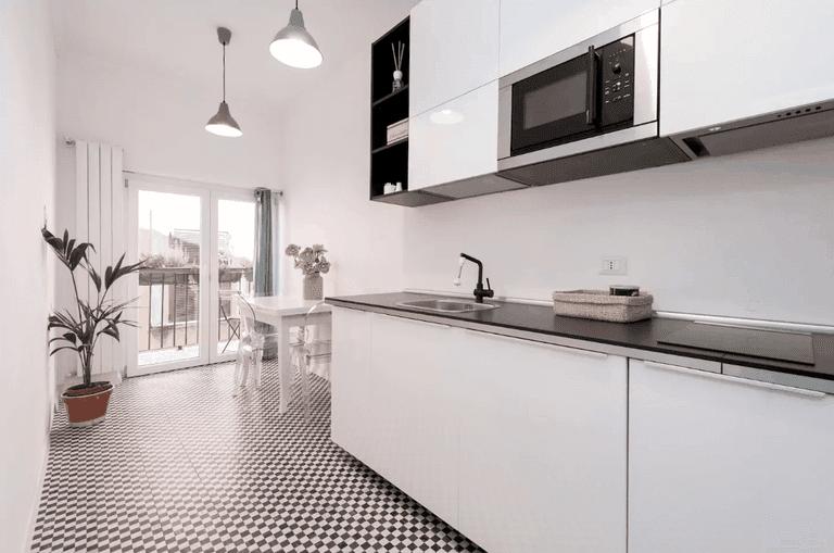The sleek kitchen of this loft apartment
