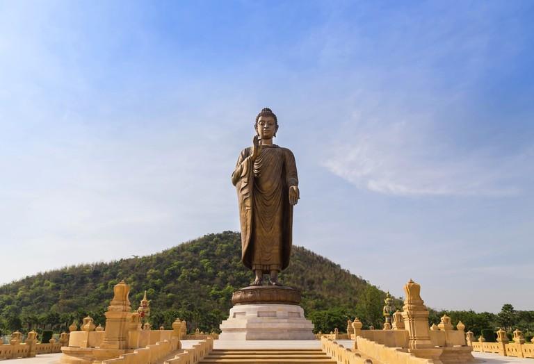 Big Buddha statue standing in Wat Thipsukhontharam Temple, Kanchanaburi, Thailand
