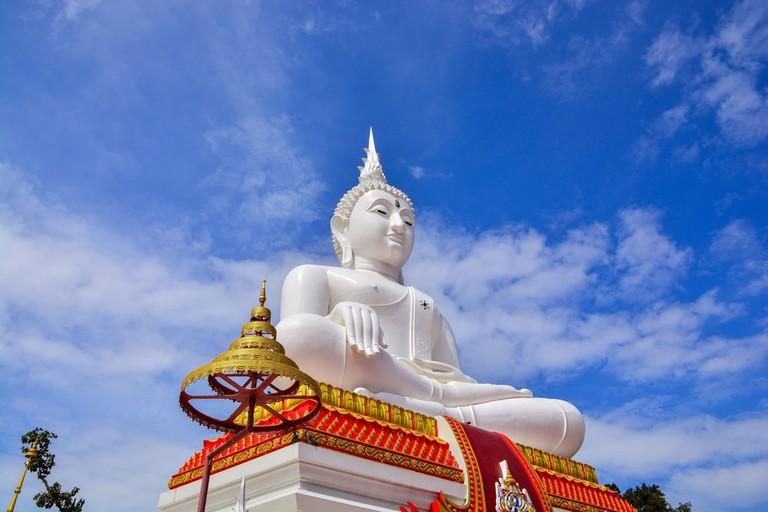 Wat Pho Kao Ton Buddhist Temple White Buddha statue in Singburi, Thailand