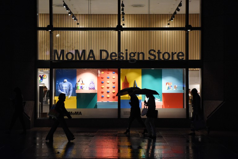 New York, USA. 22nd Oct, 2019. People walk past the MoMA Design Store in Manhattan of New York, the United States, Oct. 22, 2019. MoMA was reopened to the public on Monday after being closed since June 15 for renovation and reorganization of its galleries