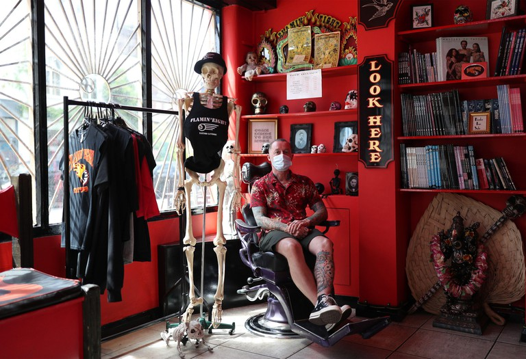 Customer Sean Murphy waits to have a tattoo done at Flamin' Eight tattoo studio in Kentish Town, London, as they reopen to customers on following the easing of lockdown restrictions in England