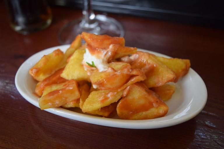 A plate of patatas bravas