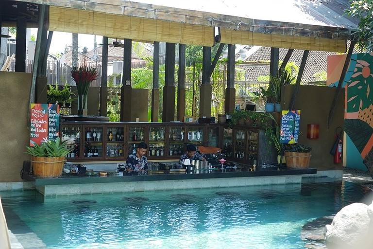 The bar and the pool at Folk Ubud