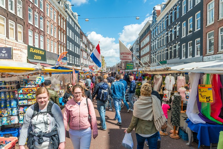 Tourists walk in Albert Cuyp Market, Amsterdam