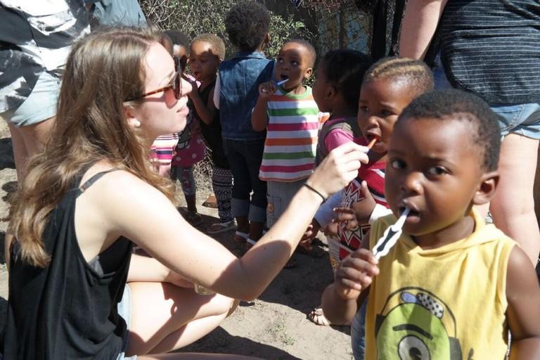Teaching children oral hygiene at Izizwe Township