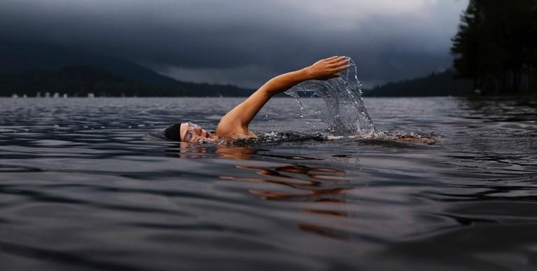 Man wild swimming