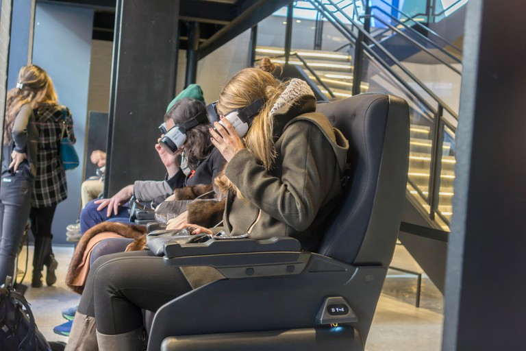 Visitors to the Samsung 837 showroom in the Meatpacking District in New York experience the Samsung VR virtual reality goggles.