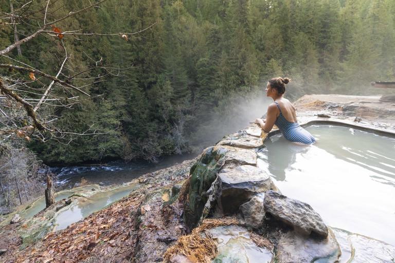 Woman relaxing at Umpqua Hot Springs, Douglas county, Oregon, United States.