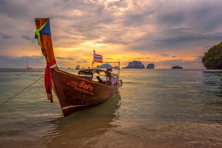 Ao Nang beach, Railay, Krabi province, Thailand: longtail boat at sunset