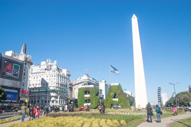 BUENOS AIRES, ARGENTINA - JULY 18, 2017: Buenos Aires sign BA covered with snow depicting the winter and Obelisk in Buenos Aires in Argentina. The Obe