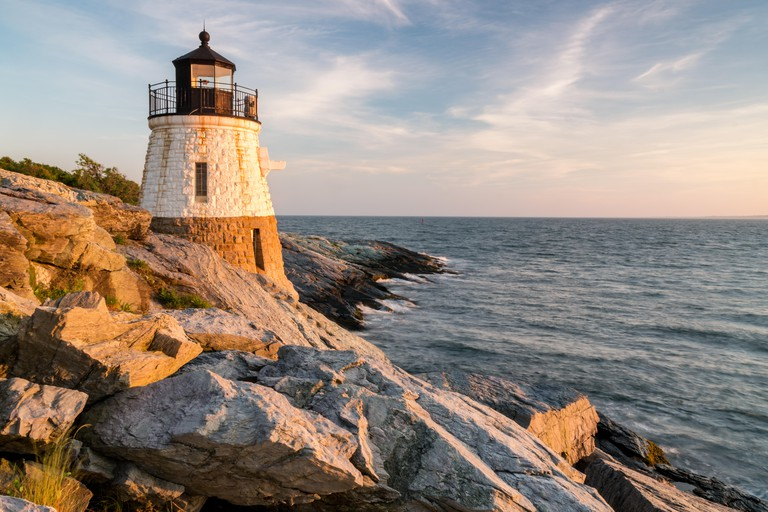 Castle Hill Lighthouse bathed with the warm glow of sunset, Newport, Rhode Island