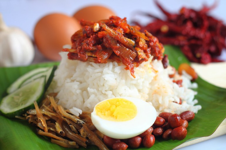 Nasi lemak is a Malay fragrant rice dish cooked in coconut milk and pandan leaf