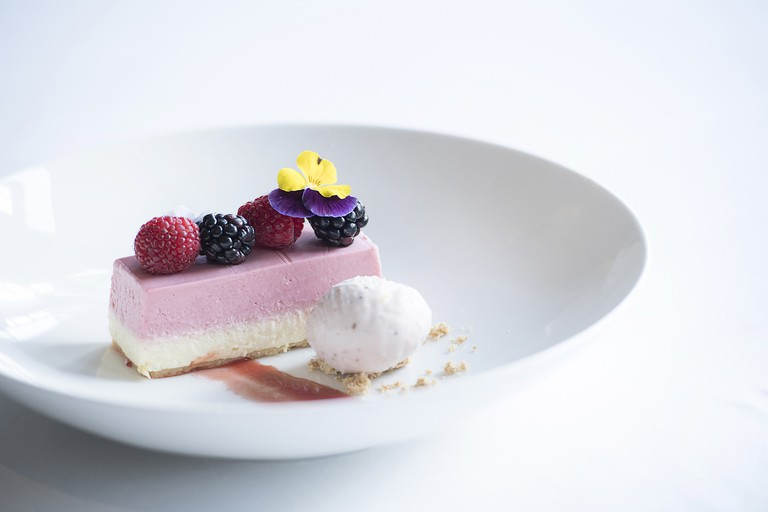 Town House serves beautifully crafted desserts like strawberry and vanilla cheesecake
