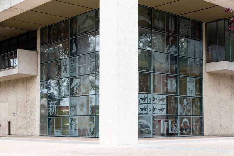 From the Outside In, a display of photographs on the atria windows of the Harry Ransom Center, an archive, library and museum at the University of Texas at Austin Physical description: 1 photograph : digital, tiff file, color.  Notes: Title, date, and ke