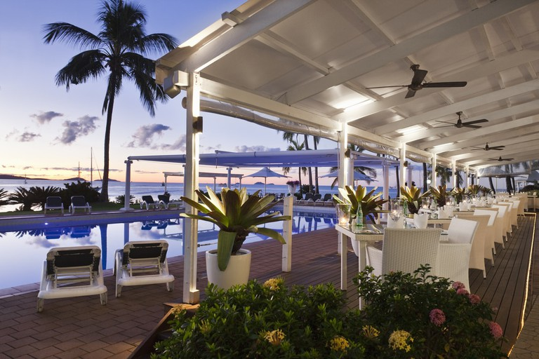 Poolside dining at Coral Sea Resort