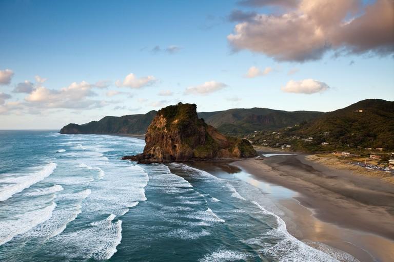Piha beach and Lion Rock at dusk. Piha, Waitakere Ranges Regional Park, Auckland, North Island, New Zealand