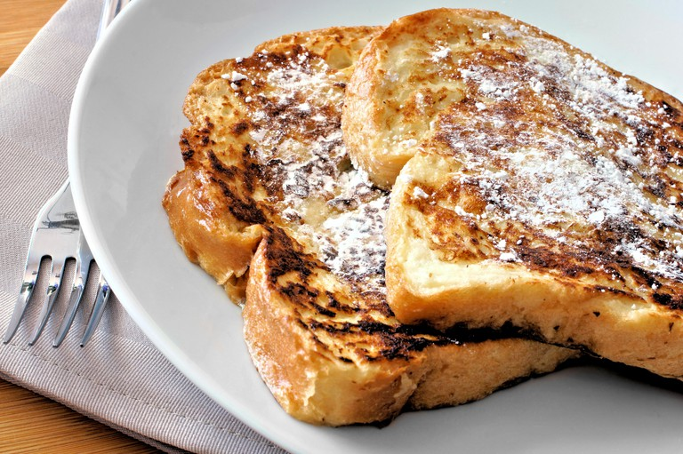 Plate of French Toast with powdered sugar close up
