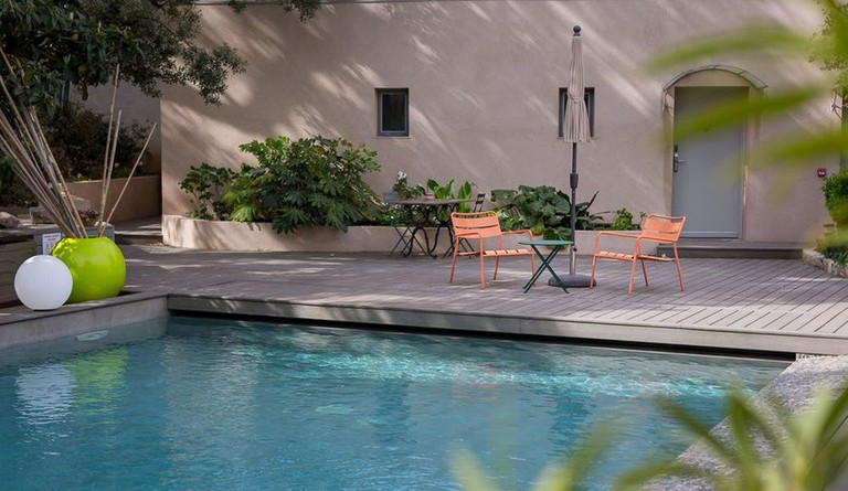 Stretch out by the pool at Hôtel 96