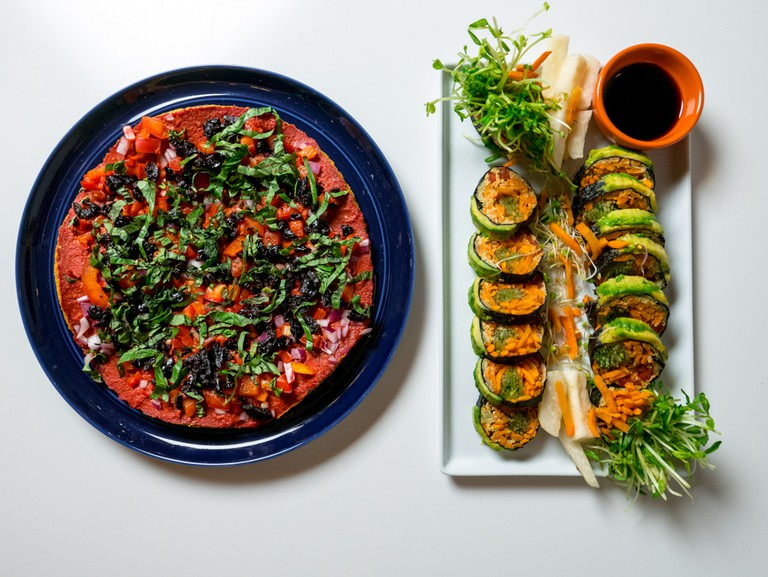 Pizza and sushi roll from Peacefood's vegan menu.