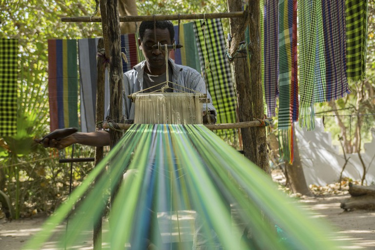 A local shows traditional weaving in Makasutu forest, The Gambia, Africa.