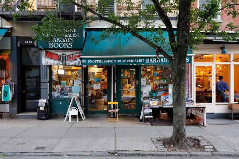 Unoppressive Non-imperialist Bargain Books, 34 Carmine St, New York, NY. exterior storefront of a bookstore in Manhattan's Greenwich Village.. Image shot 06/2018. Exact date unknown.