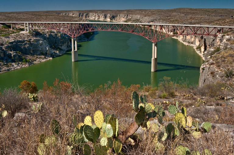 Highway bridge over Pecos River Canyon near its mouth to Rio Grande and Lake Amistad, Chihuahuan Desert near Comstock, Texas, USA