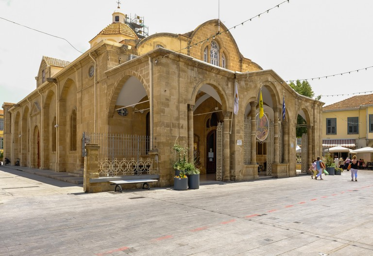 Nicosia, Cyprus - May 14, 2018: Exterior view of the Orthodox Christian Church of Holy Mary (Panagia Phaneromeni) taken in summer with people in the s