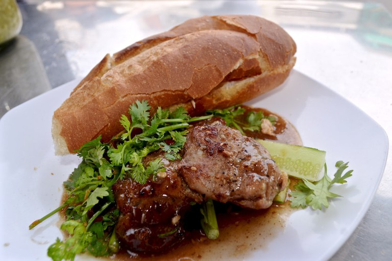 Nom pang, baguette and grilled meatballs in Cambodian gravy with green chilli sauce