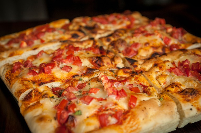 A local famous spot, Prince Street Pizza's pies are made with fresh ingredients.