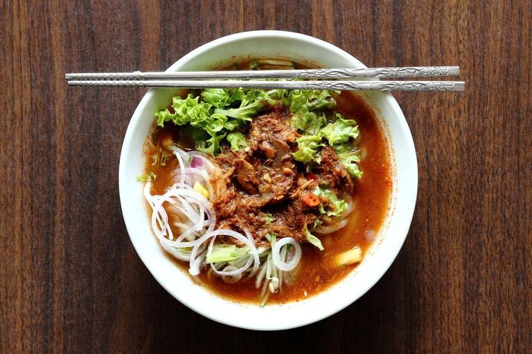 Bowl of Asam Laksa on Wooden Table